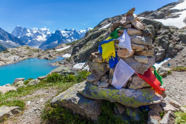 Prayer flags on a stone cairn overlooking Lac Blanc in the French Alps. I bloody love the Chamonix Valley.